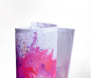 Eingerolltes, farbig bedrucktes Stoffbanner 115g Textilmaterial
